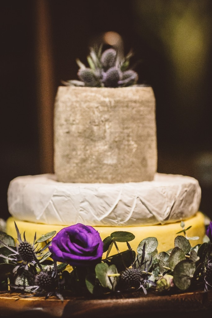 The wedding cake was changed for a cheese tower topped with thistles for a cool look