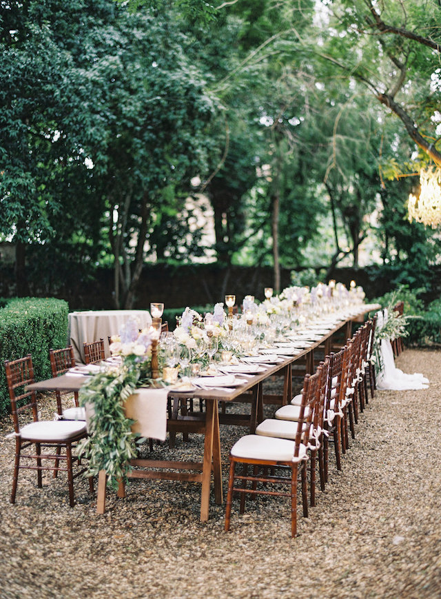 The wedding dinner was served with candles, olive branch table runners in simple yet very beautiful way