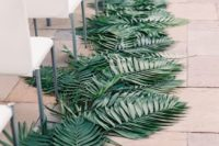 08 a palm leaf lined wedidng aisle for a modern wedding ceremony space