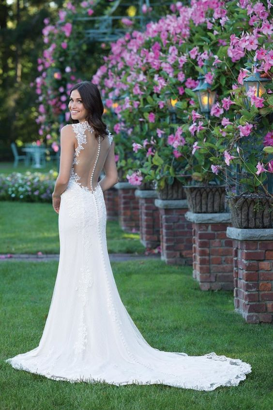 lace mermaid wedding dress with an illusion back and a button row