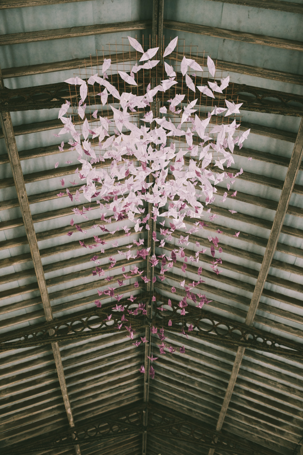 Gorgeous origami lavender chandelier was crafted by the couple
