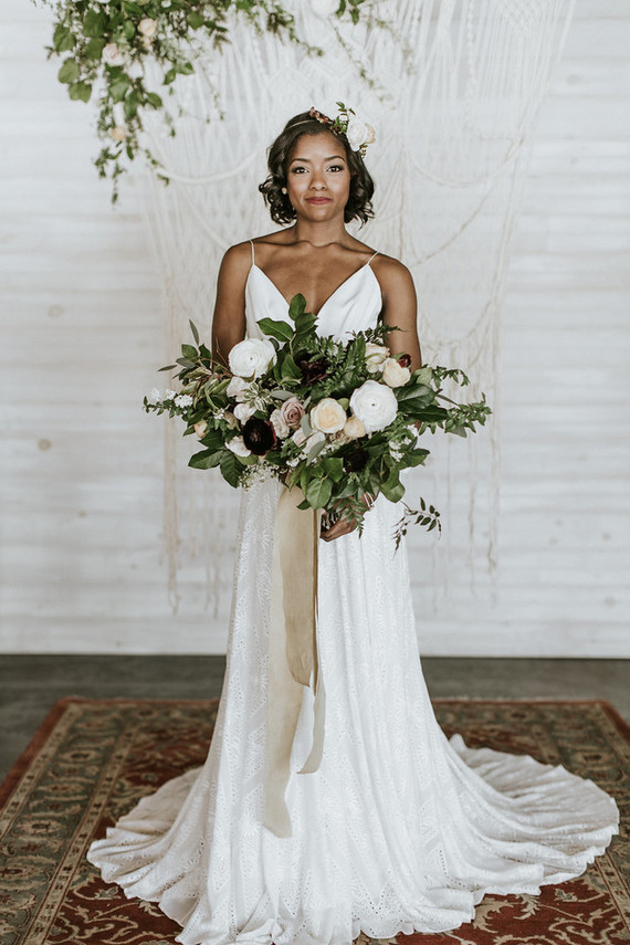 The bride was wearing a plunging neckline wedding dress with straps and a small train