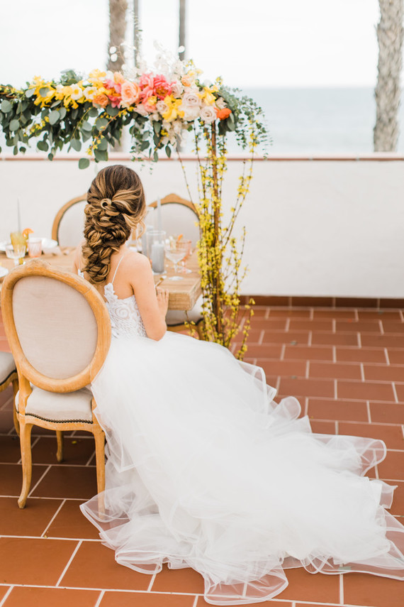 The bride with her stunning twisted low updo for a romantic feel