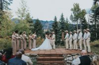 09 The ceremony took place on a special stand in the backdrop of mountain woodlands, no decor is needed with such views