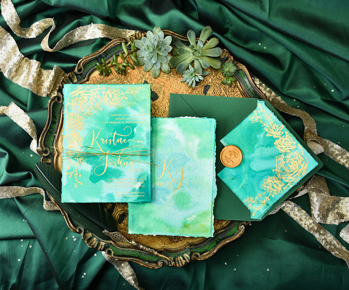 The wedding stationery was done in emerald watercolor and with gold calligraphy