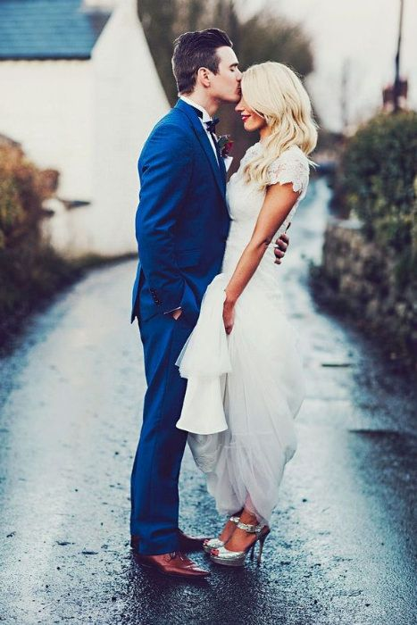 an indigo blue suit and copper shoes for a stylish groom