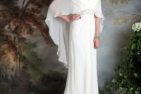 09 an ivory wedding dress with spaghetti straps and a ruffled cape attached to the embellished belt