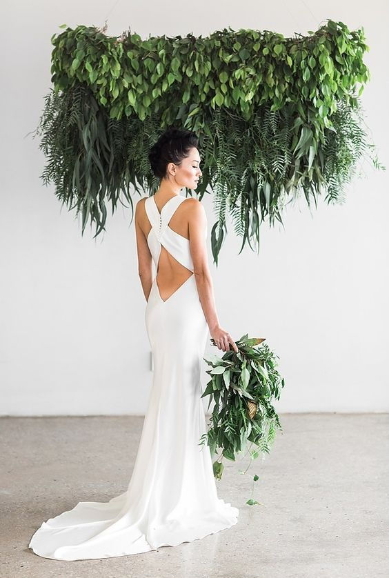 chic sheath wedding dress with a criss cross back and a small train