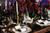 09 refined wedidng table setting with moody burgundy florals, candles and gilded details