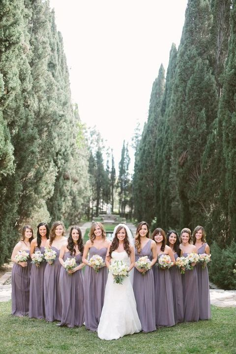 strapless maxi lavender gowns for the bridesmaids and a one shoulder one