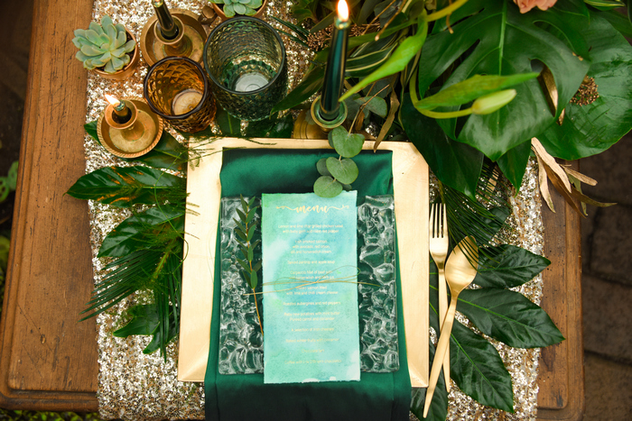 The place setting was made with gold, acryl, emerald and gold cutlery