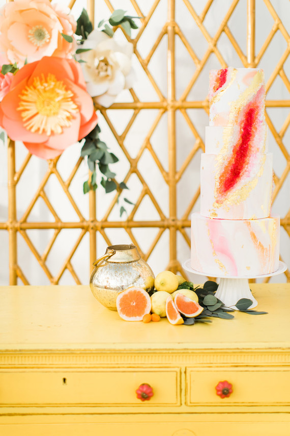 The wedding cake was pink and gold, with a trendy geode touch