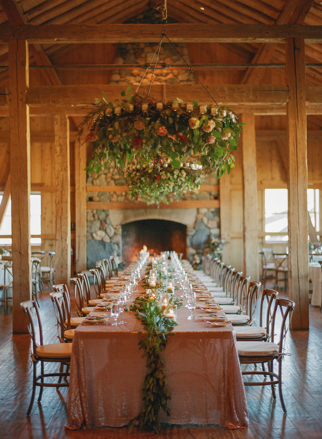 The wedding reception was rustic - greenery, blush and peachy blooms, rose sequin tablecloths and a fireplace for coziness
