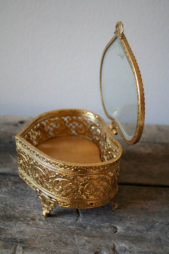 a vintage heart-shaped jewelry box with a glass top is a great idea for many girls