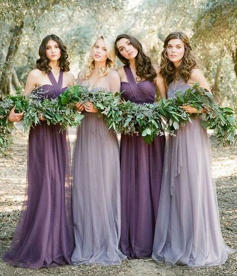 bridesmaids in lavender and purple dresses that look matching and very chic