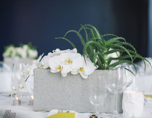 cinder block centerpiece with a succulent and white orchids