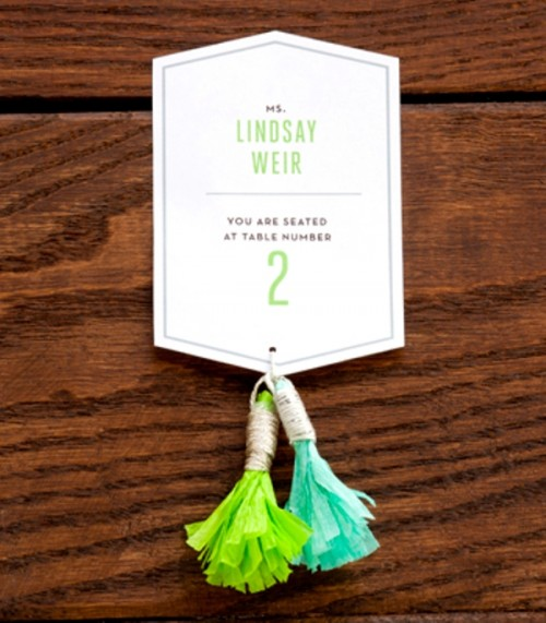 escort cards with colorful tassels look much cuter and interesting