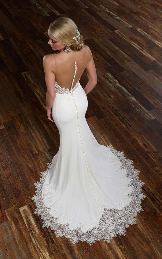 modern romantic mermaid wedding dress with an illusion back on buttons and a lace skirt edge
