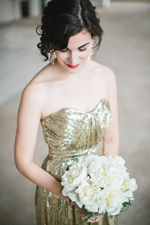 strapless gold sequin wedding dress, chandelier earrings and a red lipstick