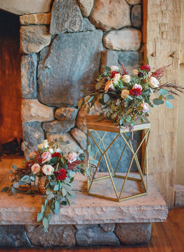 The blooms were matching the bridal bouquet, with blush, red and neutral flowers