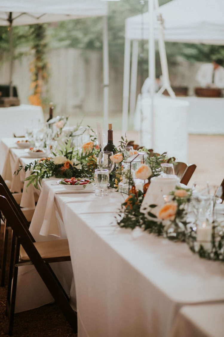 The wedding tablescape was done with geometric terrariums, peachy blooms and lots of greenery