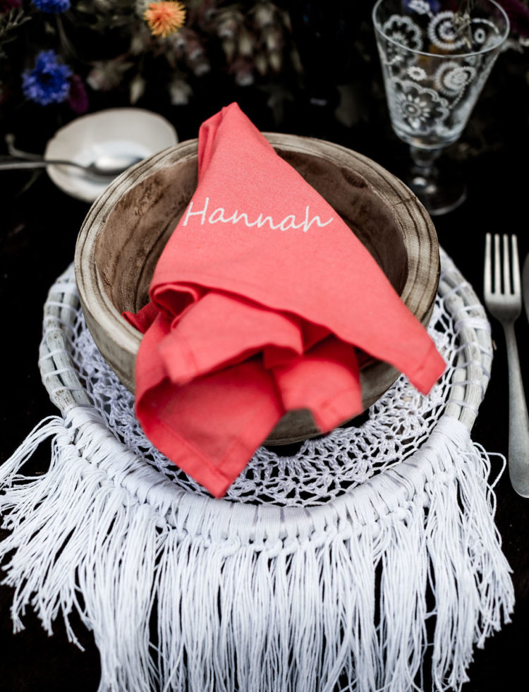 Wooden bowls and coral napkins finished off the tablescape