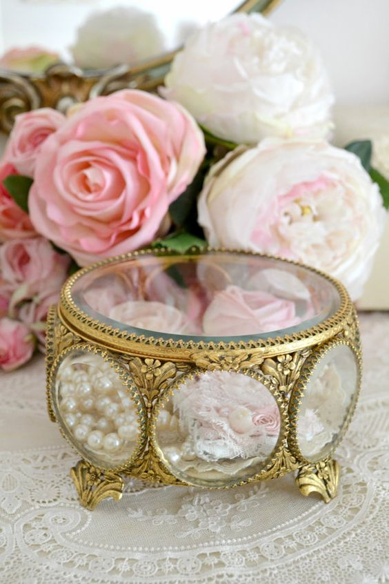 beautiful antique jewelry box with bejeweled glass and little flowers