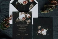 11 dark invites and a white envelope with realistic floral touches for a fall wedding