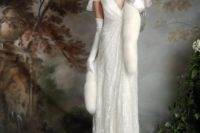 11 sparkling wedding dress with a deep V-neckline and cap sleeves, a small train and a faux fur shawl
