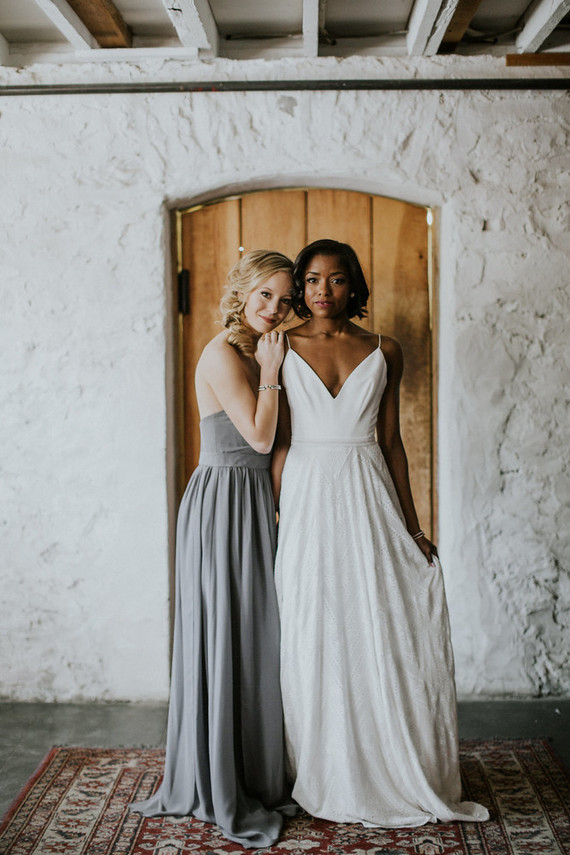 The bridesmaid was wearing a strapless grey maxi dress