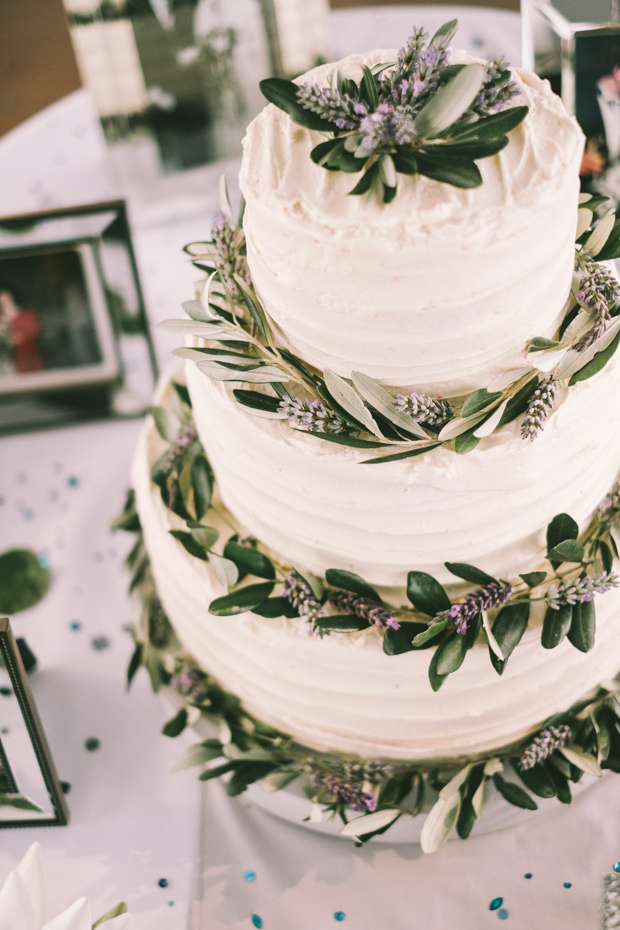 The wedding cake was topped with greenery and wildflowers