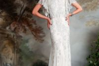 12 a bateau neckline wedding gown with flowy sleeves, embroidery and beading