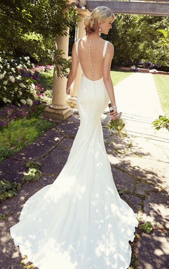 minimalist mermaid wedding dress with a train and an illusion back on rhinestone buttons