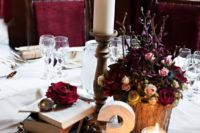 13 a Harry Potter wedding tablescape with vintage books, moody blooms and candles