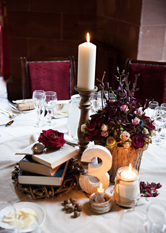 a Harry Potter wedding tablescape with vintage books, moody blooms and candles