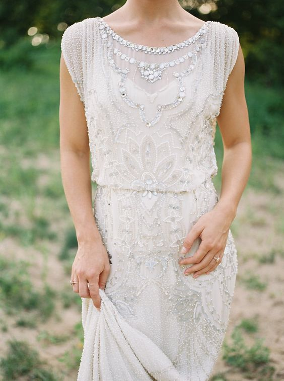 a beautiful scoop neckline wedding dress with beading, rhinestones and embroidery, without sleeves