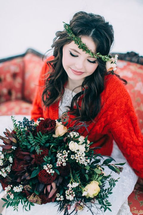 a cozy cable knit hot red cardigan to keep a winter bride cozy