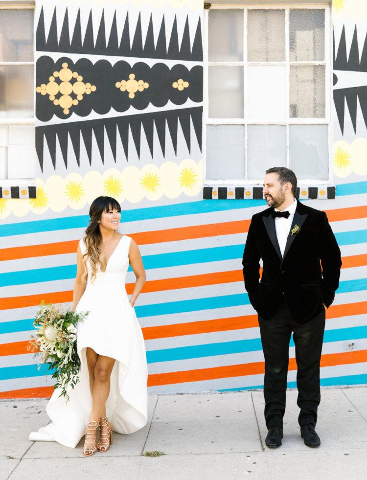 a gorgeous plunging neckline wide strap high low wedding dress with metallic heels