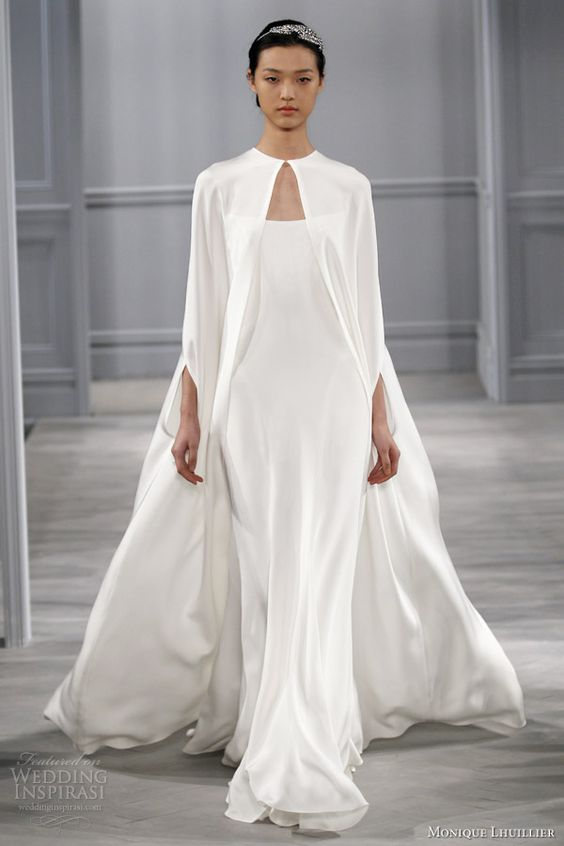 a minimalist spaghetti strap wedding dress and a cape over it for a statement