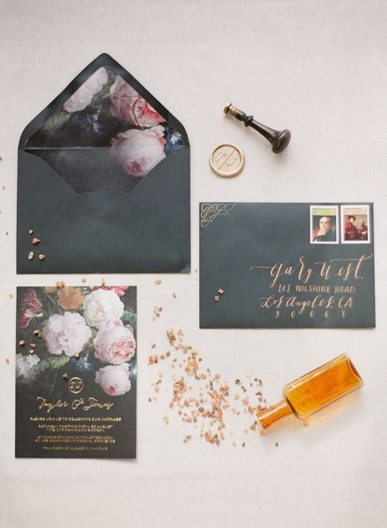 black wedding stationery with realistic pink floral lining and gold calligraphy