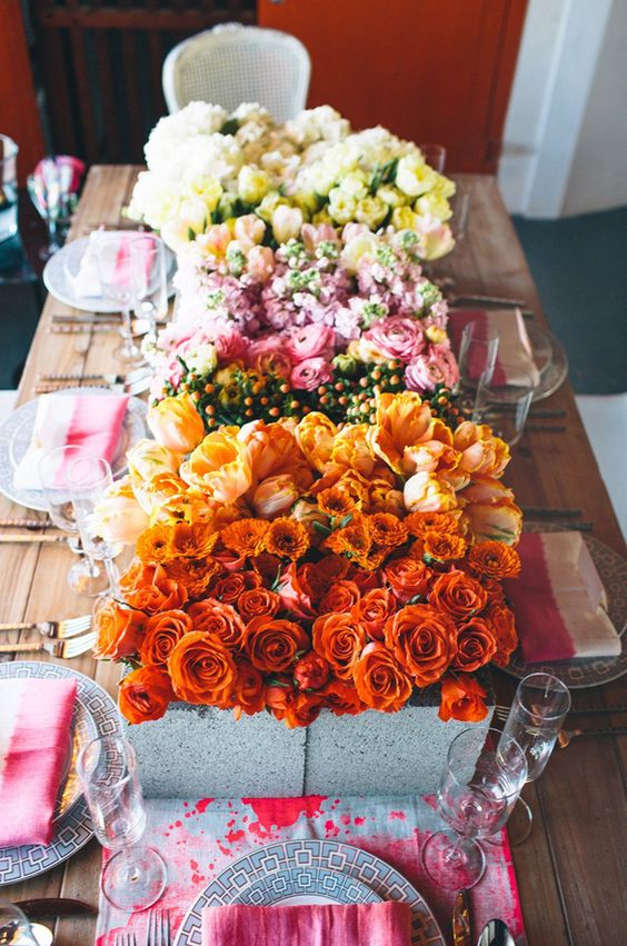 concrete boxes with bold blooms of various shades to create a gorgeous table runner