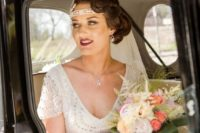 14 a deep V-neck wedding dress with heavy beading, cap sleeves, matching accessories and hair