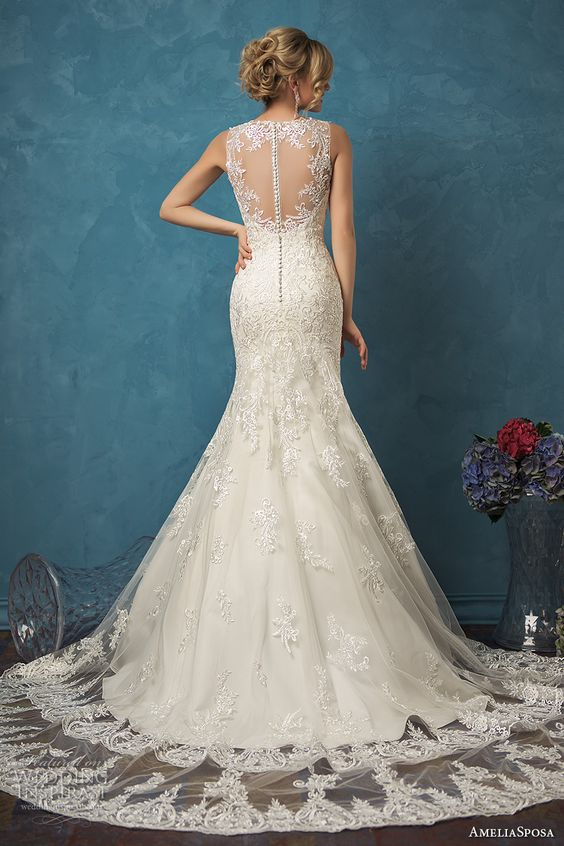 sleeveless mermaid lace wedding dress with an illusion back on buttons and a lace overskirt