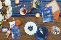 14 watercolor indigo menus and a table runner with copper accents make this tablescape amazing