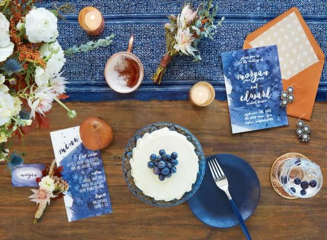watercolor indigo menus and a table runner with copper accents make this tablescape amazing