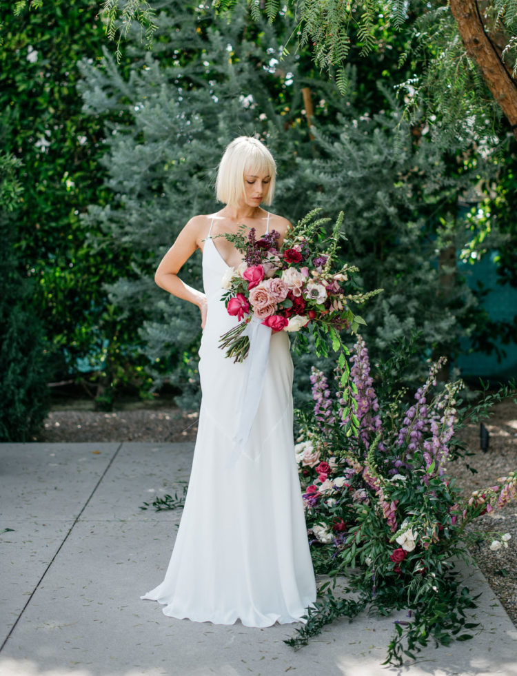 a minimalist wedding dress on spaghetti straps with a plunging neckline and a low back