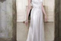 15 a sparkling art deco wedding dress with a deep V-neckline, cap sleeves, intricate beading and rhinestones