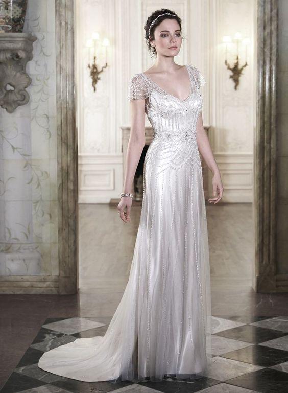 a sparkling art deco wedding dress with a deep V-neckline, cap sleeves, intricate beading and rhinestones
