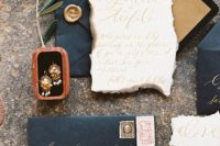 15 black wedding envelopes with gold calligraphy and neutral invites with a raw edge