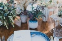 16 a coastal table setting accentuated with indigo vases and beautifully painted plates